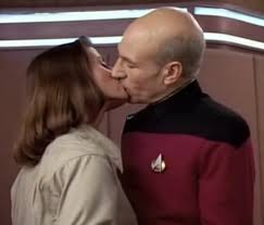 Two archaeologists kissing