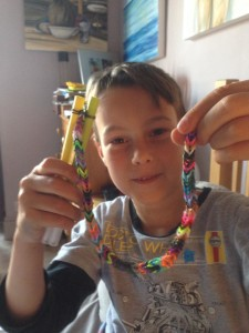 My son with his loom creation