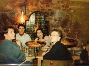 Me and three handsome young men eating huge pizzas