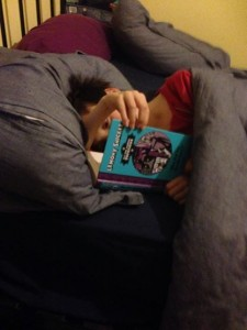 Oldest son reading in bed