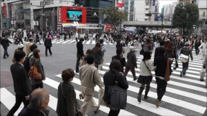 In Tokyo people cross the road when the green light is showing, not in London